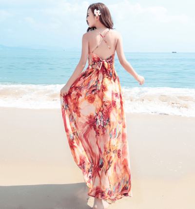 Đầm maxi đan dây phần sau lưng phù hợp cho những chuyến đi biển